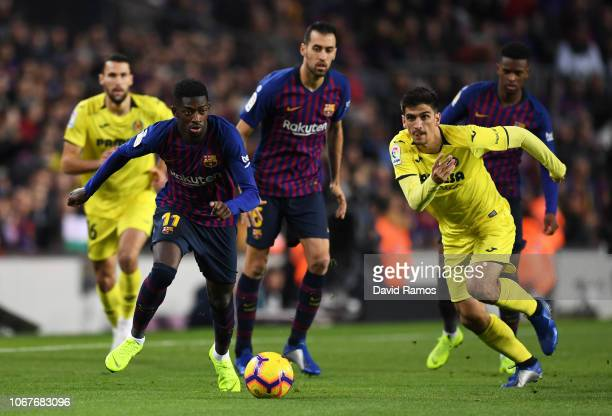 Ousmane Dembele of Barcelona is chased by Gerard Moreno of Villareal during the La Liga match between FC Barcelona and Villarreal CF at Camp Nou on...