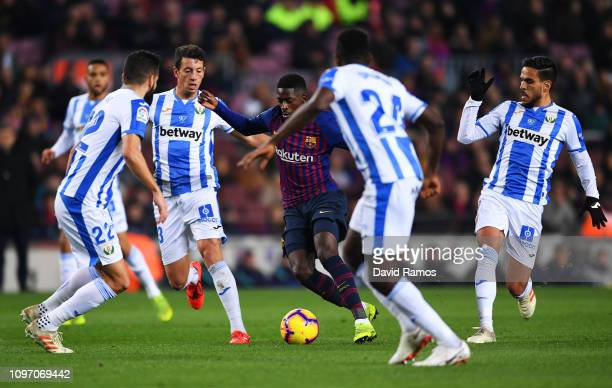 Ousmane Dembele of Barcelona is surrounded by Leganes players during the La Liga match between FC Barcelona and CD Leganes at Camp Nou on January 20...