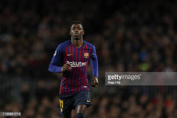 Ousmane Dembele of Barcelona looks on during the UEFA Champions League Round of 16 Second Leg match between FC Barcelona and Olympique Lyonnais at...