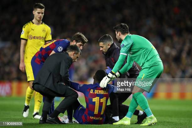 Ousmane Dembele of Barcelona receives medical help during the UEFA Champions League group F match between FC Barcelona and Borussia Dortmund at Camp...