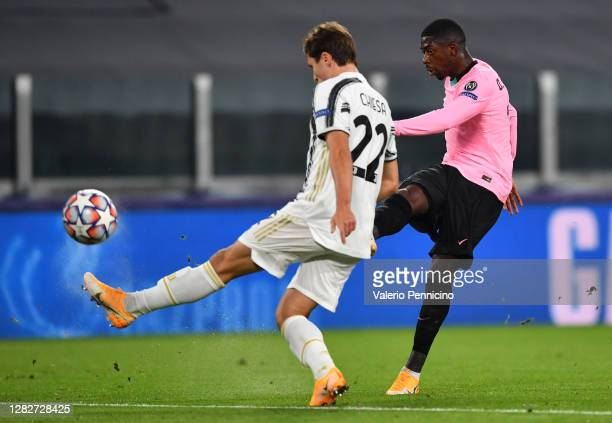 Ousmane Dembele of Barcelona scores his sides first goal whilst under pressure from Federico Chiesa of Juventus during the UEFA Champions League...