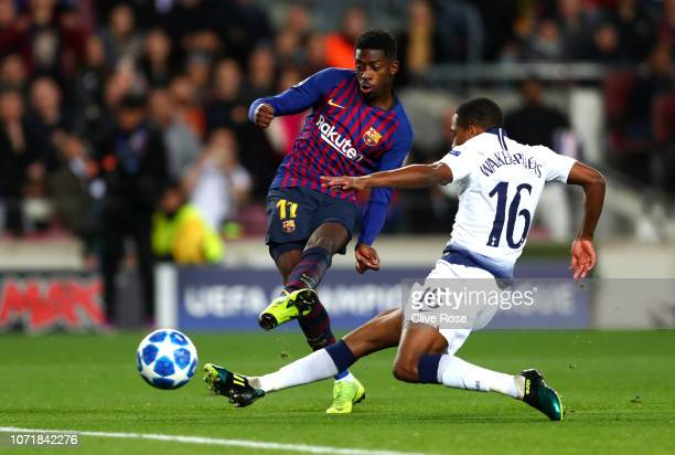 Ousmane Dembele of Barcelona scores his team's first goal as Kyle WalkersPeters of Tottenham Hotspur challenges during the UEFA Champions League...