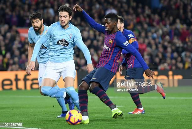 Ousmane Dembele of Barcelona scores his team's first goal during the La Liga match between FC Barcelona and RC Celta de Vigo at Camp Nou on December...