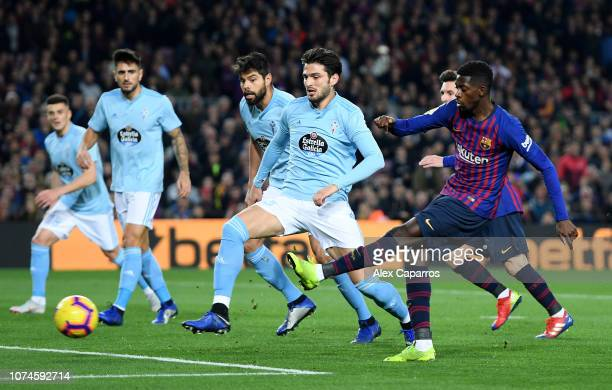 Ousmane Dembele of Barcelona scores his team's first goal during the La Liga match between FC Barcelona and RC Celta de Vigo at Camp Nou on December...