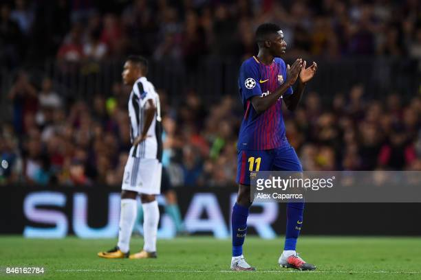 Ousmane Dembele of Barcelona shows appreciation to the fans as he walks off to be subbed during the UEFA Champions League Group D match between FC...