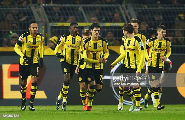Ousmane Dembele of Borussia Dortmund celebrates scoring his team's opening goal with team mates during the Bundesliga match between Borussia Dortmund...