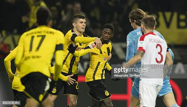 Ousmane Dembele of Borussia Dortmund celebrates scoring the goal to the 11 during the Bundesliga match between Borussia Dortmund and FC Augsburg at...