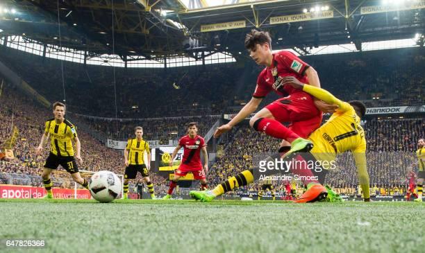 Ousmane Dembele of Borussia Dortmund challenges Kai Havertz of Leverkusen during the Bundesliga match between Borussia Dortmund and Bayer 04...