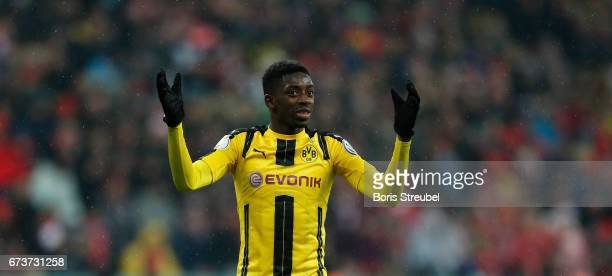 Ousmane Dembele of Borussia Dortmund gestures during the DFB Cup semi final match between FC Bayern Muenchen and Borussia Dortmund at Allianz Arena...