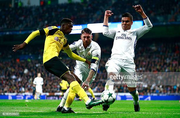 Ousmane Dembele of Borussia Dortmund is tackled by Sergio Ramos of Real Madrid and Casemiro of Real Madrid during the UEFA Champions League Group F...