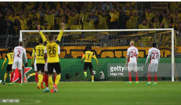 Ousmane Dembele of Borussia Dortmund scores his team's first goal of the game during the UEFA Champions League Quarter Final first leg match between...