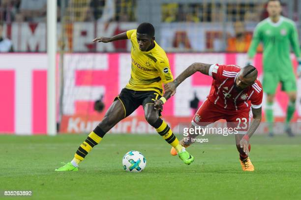 Ousmane Dembele of Dortmund and Arturo Vidal of Bayern Muenchen battle for the ball during the DFL Supercup 2017 match between Borussia Dortmund and...