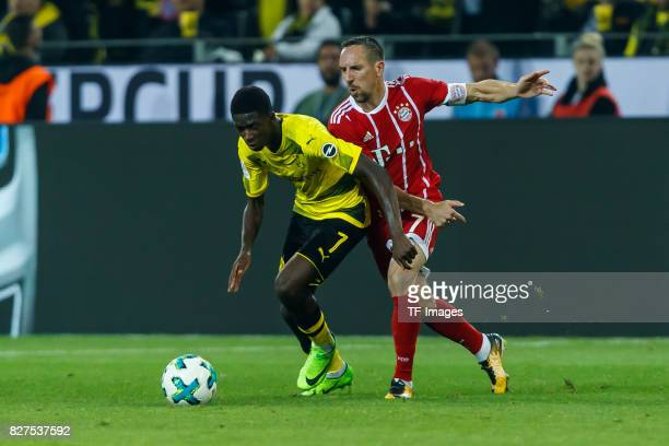 Ousmane Dembele of Dortmund and Franck Ribery of Bayern Muenchen battle for the ball during the DFL Supercup 2017 match between Borussia Dortmund and...