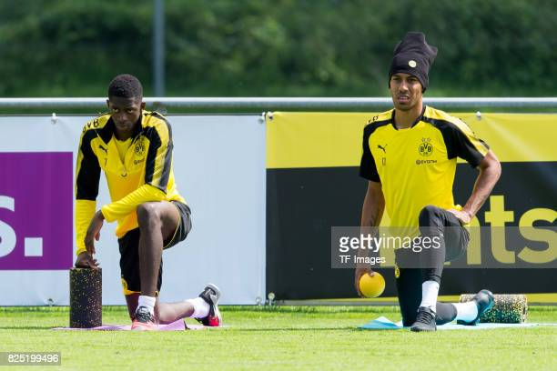 Ousmane Dembele of Dortmund and PierreEmerick Aubameyang of Dortmund looks on during a training session as part of the training camp on July 29 2017...