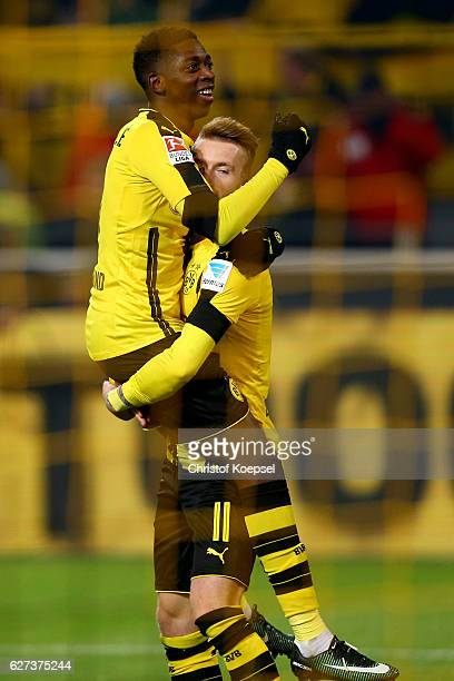 Ousmane Dembele of Dortmund celebrates the third goal with Marco Reus during the Bundesliga match between Borussia Dortmund and Borussia...