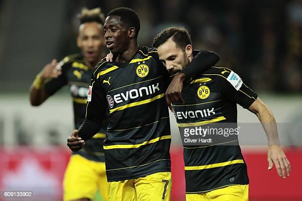 Ousmane Dembele of Dortmund celebrates with teammates after his team's goal during the Bundesliga match between VfL Wolfsburg and Borussia Dortmund...
