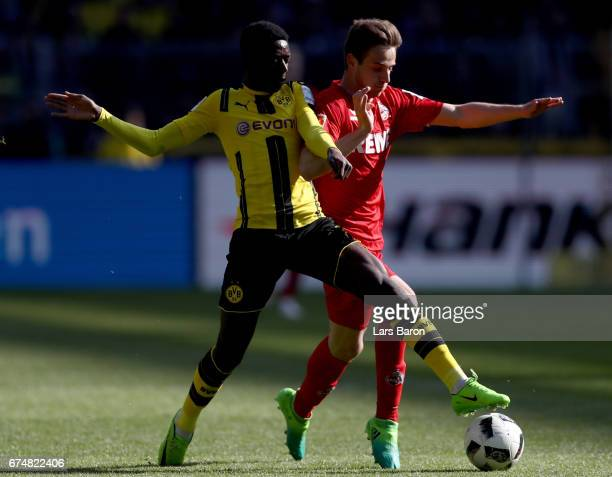 Ousmane Dembele of Dortmund challenges Lukas Kluenter of Koeln during the Bundesliga match between Borussia Dortmund and 1 FC Koeln at Signal Iduna...