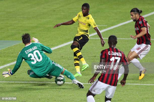 Ousmane Dembele of Dortmund in action against Marco Storari of AC Milan during the 2017 International Champions Cup football match between AC Milan...