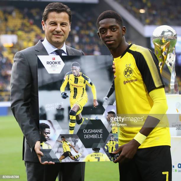 Ousmane Dembele of Dortmund poses with DFL CEO Christian Seifert and his 'Rookie 2017' award prior to the DFL Supercup 2017 match between Borussia...