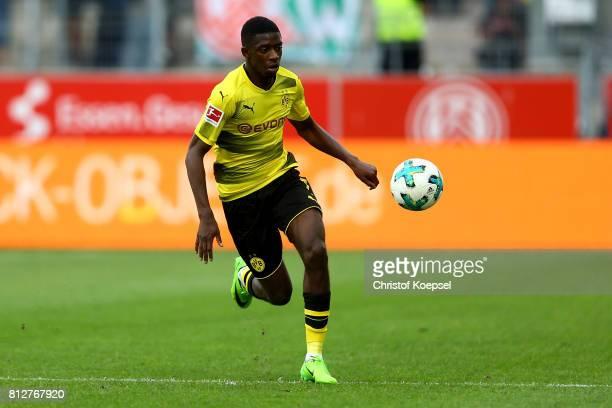 Ousmane Dembele of Dortmund runs with the ball during the preseason friendly match between RotWeiss Essen and Borussia Dortmund at Stadion Essen on...