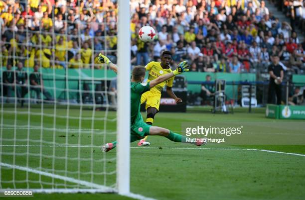 Ousmane Dembele of Dortmund scores his team's first goal past goalkeeper Lukas Hradecky during the DFB Cup Final 2017 between Eintracht Frankfurt and...