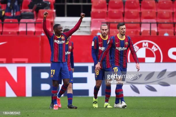 Ousmane Dembele of FC Barcelona celebrates after scoring their side's first goal during the La Liga Santander match between Sevilla FC and FC...