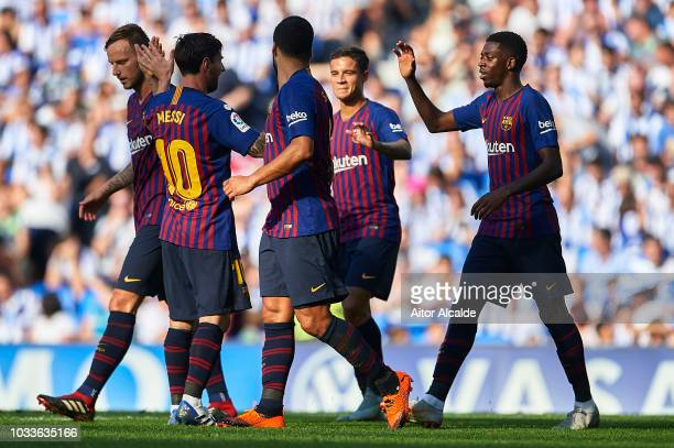 Ousmane Dembele of FC Barcelona celebrates after scoring with Lionel Messi of FC Barcelona during the La Liga match between Real Sociedad and FC...