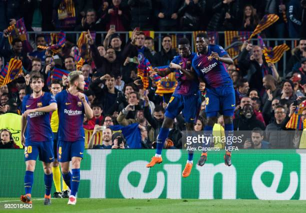 Ousmane Dembele of FC Barcelona celebrates with his teammate Samuel Umtiti after scoring his team's second goal during the UEFA Champions League...