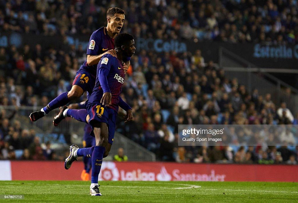 Ousmane Dembele of FC Barcelona celebrates with his team-mates after scoring his team's first goal during the La Liga match between Celta de Vigo and Barcelona at Balaidos Stadium on April 17, 2018 in Vigo, Spain.