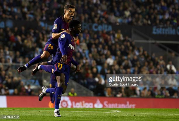 Ousmane Dembele of FC Barcelona celebrates with his teammates after scoring his team's first goal during the La Liga match between Celta de Vigo and...
