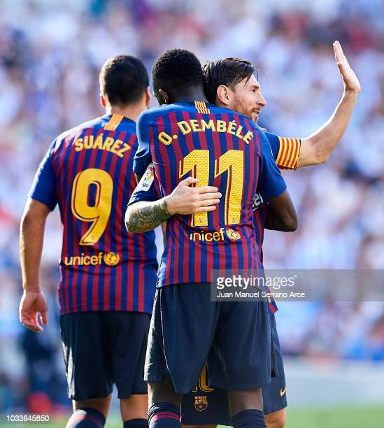 Ousmane Dembele of FC Barcelona celebrates with his teammates Lionel Messi of FC Barcelona after scoring his team's second goal during the La Liga...