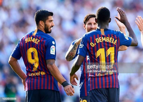 Ousmane Dembele of FC Barcelona celebrates with his teammates Lionel Messi and Luis Suarez of FC Barcelona after scoring his team's second goal...