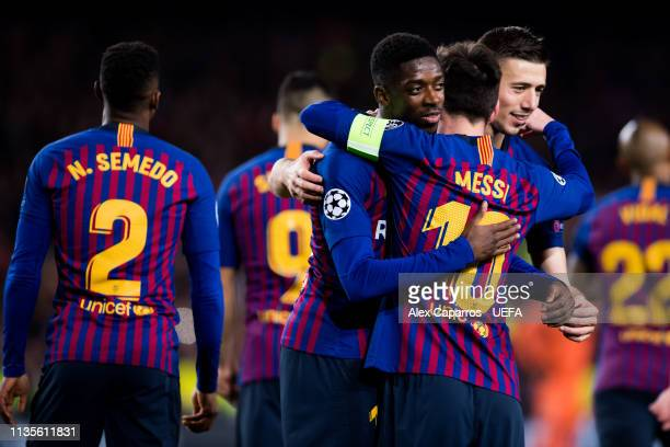 Ousmane Dembele of FC Barcelona celebrates with his teammates Lionel Messi and Clement Lenglet after scoring his team's fifth goal during the UEFA...
