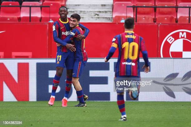 Ousmane Dembele of FC Barcelona celebrates with team mate Pedri after scoring their side's first goal during the La Liga Santander match between...
