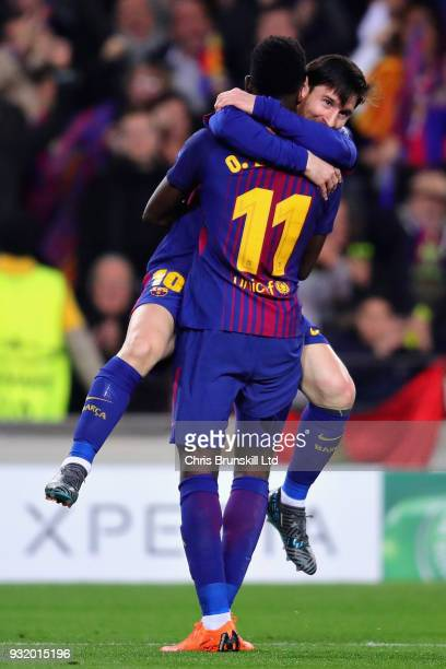 Ousmane Dembele of FC Barcelona celebrates with teammate Lionel Messi after scoring his sides second goal during the UEFA Champions League Round of...