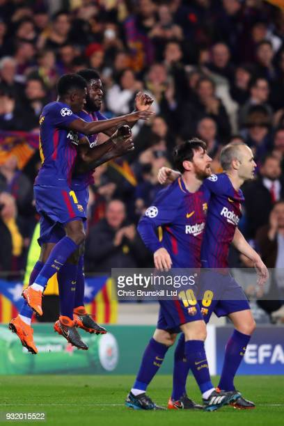 Ousmane Dembele of FC Barcelona celebrates with teammate Samuel Umtiti during the UEFA Champions League Round of 16 Second Leg match between FC...