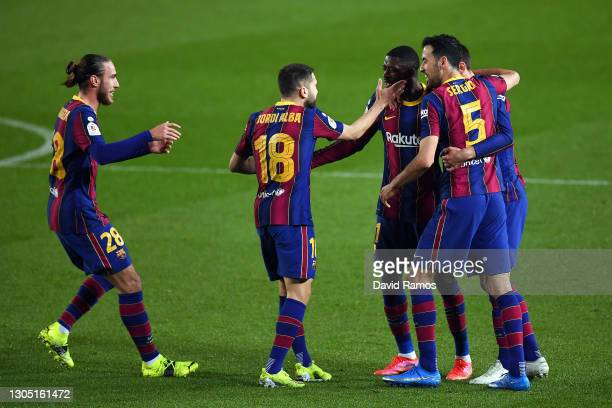 Ousmane Dembele of FC Barcelona celebrates with teammates Jordi Alba and Sergio Busquets after scoring their team's first goal during the Copa del...