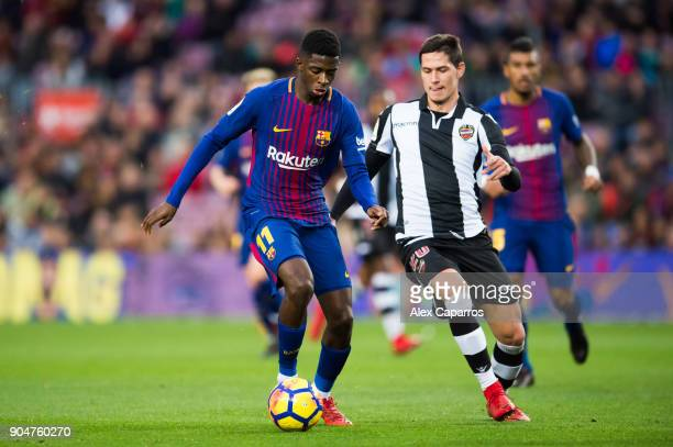 Ousmane Dembele of FC Barcelona conducts the ball under pressure from Sasa Lukic of Levante UD during the La Liga match between Barcelona and Levante...