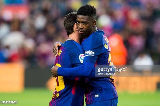 Ousmane Dembele of FC Barcelona embraces his teammate Lionel Messi of FC Barcelona before the La Liga match between Barcelona and Levante at Camp Nou...