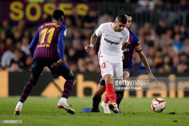 Ousmane Dembele of FC Barcelona Ever Banega of Sevilla FC Sergio Busquets of FC Barcelona during the La Liga Santander match between FC Barcelona v...