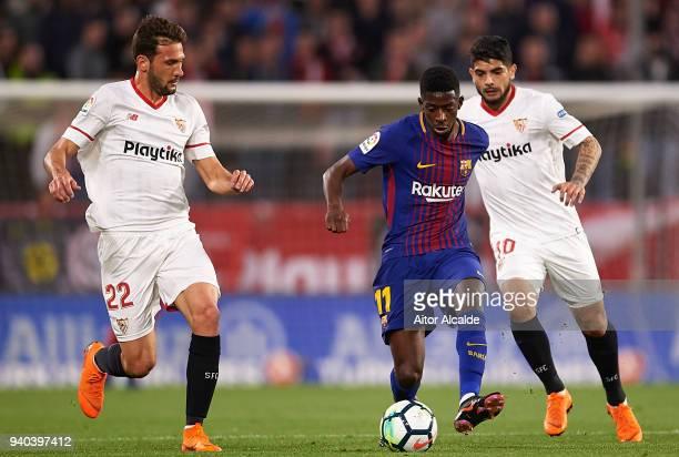 Ousmane Dembele of FC Barcelona f Franco Vazquez of Sevilla FC and Ever Banega of Sevilla FC during the La Liga match between Sevilla CF and FC...