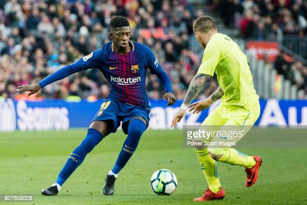 Ousmane Dembele of FC Barcelona fights for the ball with Vitorino Gabriel Pacheco Antunes of Getafe CF during the La Liga 2017-18 match between FC...