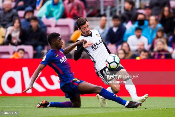 Ousmane Dembele of FC Barcelona fouls Jose Gaya of Valencia CF inside the penalty box during the La Liga match between Barcelona and Valencia at Camp...