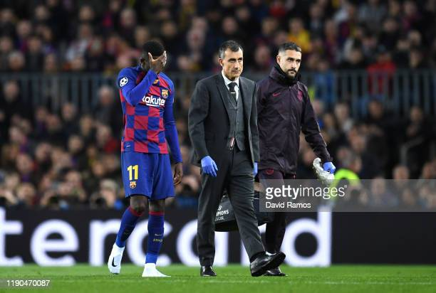 Ousmane Dembele of FC Barcelona leaves the pitch with an injury during the UEFA Champions League group F match between FC Barcelona and Borussia...