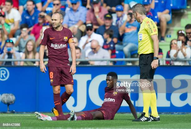 Ousmane Dembele of FC Barcelona lies injured during the La Liga match between Getafe and Barcelona at Coliseum Alfonso Perez on September 16 2017 in...