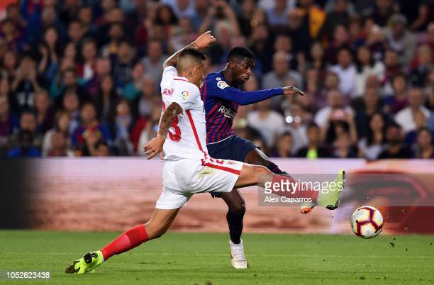 Ousmane Dembele of FC Barcelona looks to shoot under pressure from Guilherme Arana Lopes of Sevilla FC during the La Liga match between FC Barcelona...