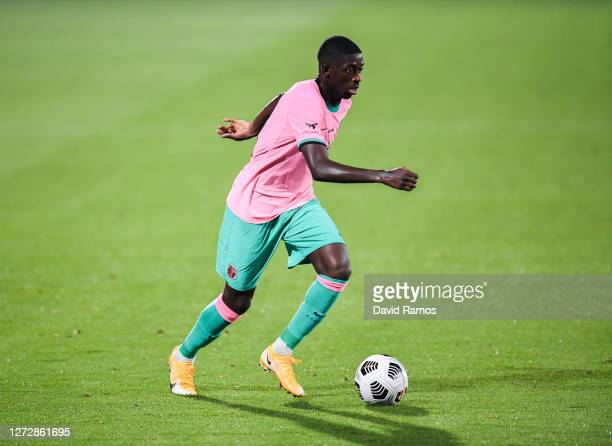 Ousmane Dembele of FC Barcelona runs with the ball during the during the pre-season friendly match between FC Barcelona and Girona at Estadi Johan...