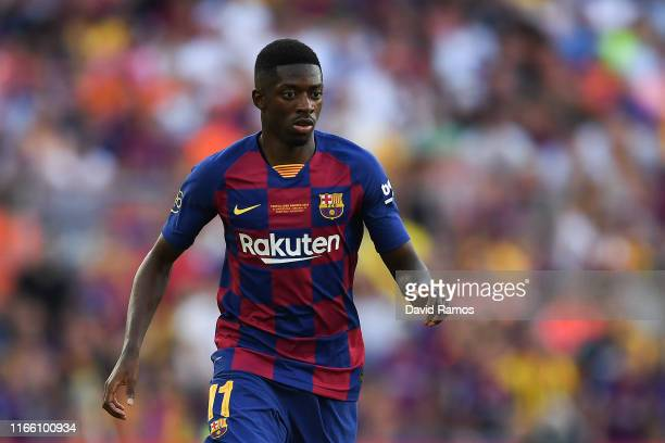 Ousmane Dembele of FC Barcelona runs with the ball during the Joan Gamper trophy friendly match between FC Barcelona and Arsenal at Nou Camp on...