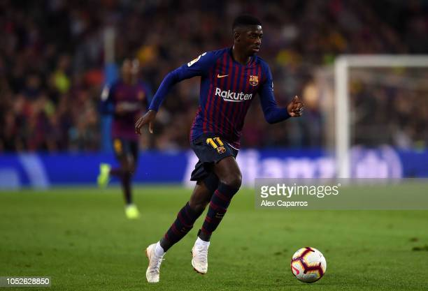 Ousmane Dembele of FC Barcelona runs with the ball during the La Liga match between FC Barcelona and Sevilla FC at Camp Nou on October 20 2018 in...