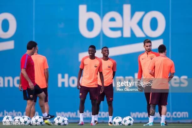 Ousmane Dembele of FC Barcelona smiles during a training session ahead of the UEFA Champions League Group D match against Juventus on September 11...